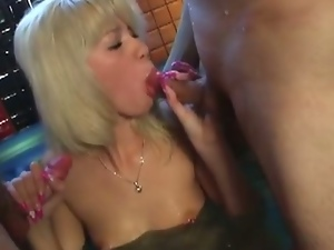 Filthy college chick sucks two dicks in sauna