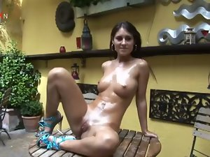 Cute brunette enjoys a dildo session in garden