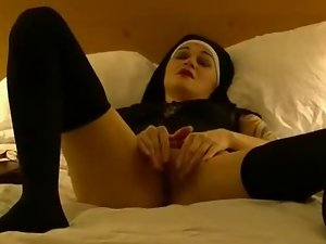 nun masturbating in bed