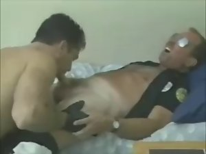Cop Daddy Erik stroked by Young man