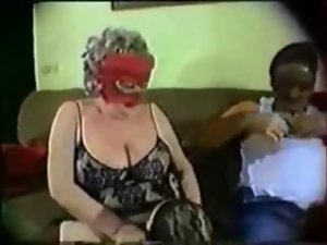 Experienced masked granny having fun