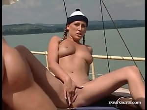 Goddess with pigtails double penetrated on a boat