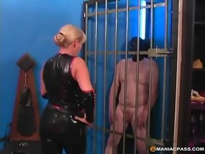 Saucy milf dominatrix cageds her masked sex slave to tease him