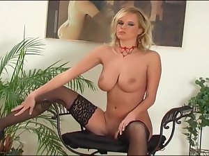 Blonde with huge boobs stripping in black lingerie