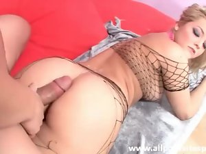 Hottie in fishnet suit gets her ass filled with meat