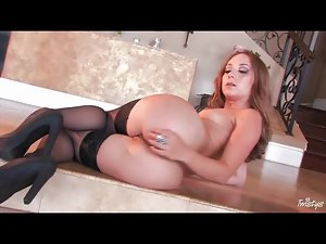 Brunette in stockings plays with her shaved pussy