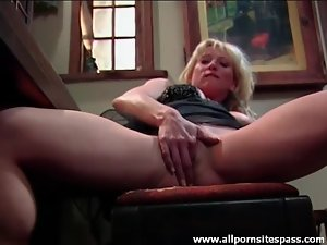 Busty beauty masturbates on a piano bench
