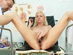Blonde with doctor takes enema in her pussy