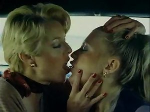 Retro lesbo sex in back of limousine