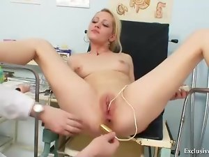 Doctor in gloves looks into her pussy
