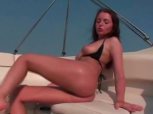 Sexy girl on a boat fingers solo