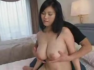 He fondles her really big natural Japanese tits