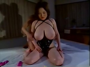 Japanese girl in latex corset big titty play