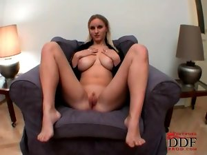 Blonde with her legs spread has big titties