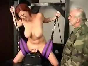 Busty redhead in bondage vibrated