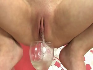 Chick strokes up the urine from her adult sexual object after wanking