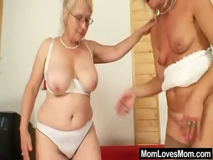 Well-endowed grandma penetrates a mum