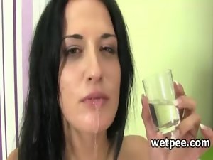 Slutty girl in pantyhose fake penis self screws and drinks her piss