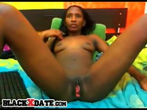 Ebony young lady spreads her legs and teasing