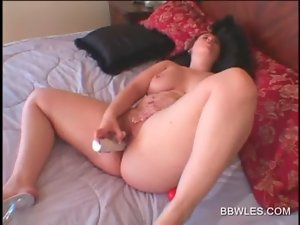 Nude Obese doll screwing herself with a vibrating sex toy