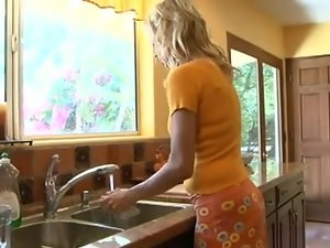 Tempting blonde Mommy in the kitchen