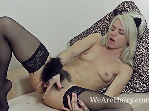 Stockings make hirsute chick Selena sensual and wild