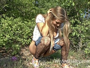 Hirsute wench Riana S find enjoyment in her walk outside