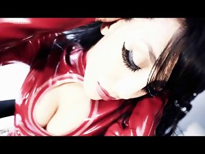 Chick in Red Latex Masturbates