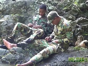 Army lads scout for brutal meat outdoors