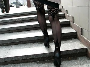 Lass in fashion fishnet stockings going upstair