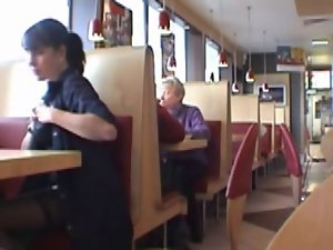 Dark haired flashing at restaurant
