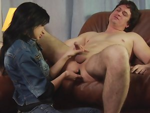 Dominating whore bangs a guy's bum with a strap on