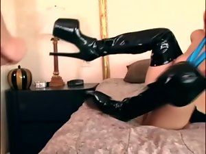 Ebony thigh high boot sex with a leggy dark haired