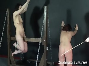 Wooden horse bondage and palm spanking of two caned lezzy slave slutty chicks in extre