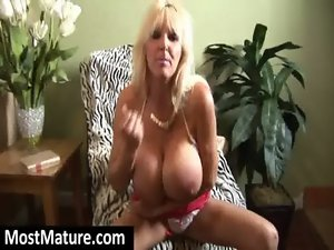 attractive mature light-haired with huge artificial knockers