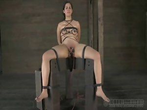Restrained girlie is punished