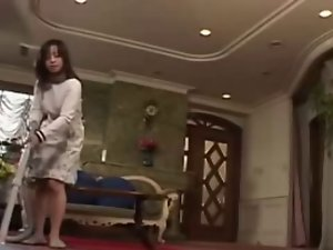 Asian Married woman serves her Husband when he gets Home
