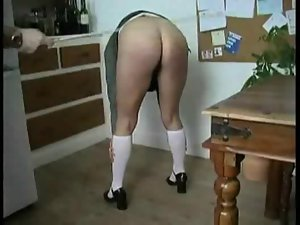 Bad schoolgirl gets caned and roughly banged in both holes