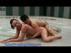 Strong lesbos wrestling oiled bodies