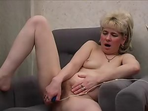 Ugly mother with tiny flabby knockers play her very hairy pussy