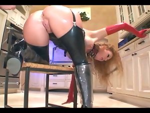 Crazy lady in latex lingerie and a corset banging