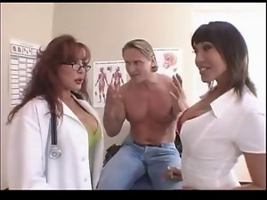 2 Woman Doctors Receive On Their Muscular Patient.