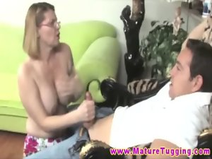 Top heavy aged spex mommy tugging on shaft for happy fellow