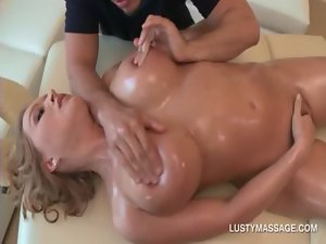 Kinky masseur fingering oily cunt and rubbing enormous tits