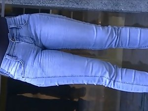 Talkative dark haired in narrow jeans pants
