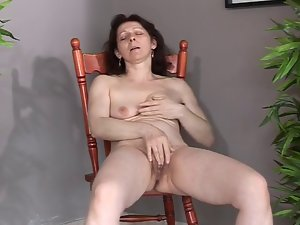 Attractive mature with puny saggy hooters makes herself cum and squirt