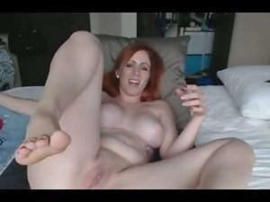 redhead plays with feet