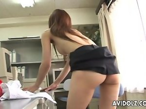 Asian slutty girl is rubbing on her perfect clit wild