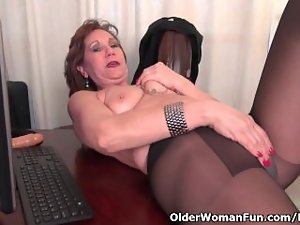 Office granny in pantyhose works her aged cunt