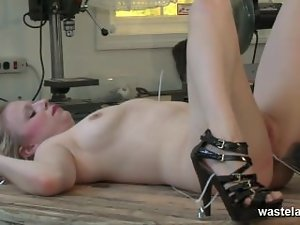 Tempting blonde slave is tied down on the table and flogged